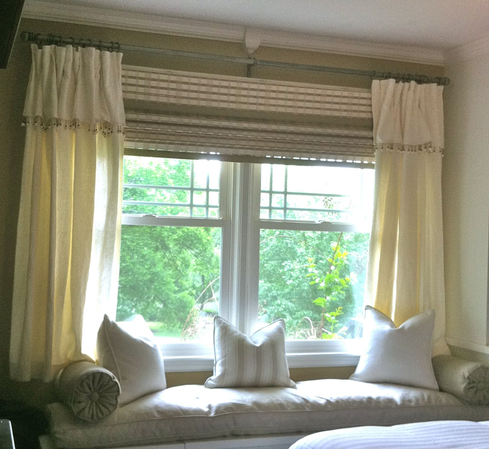 Bay window with window seat treatments - Depiction Of How To Choose The Right Window Treatments For Wide Windows So That They Appear