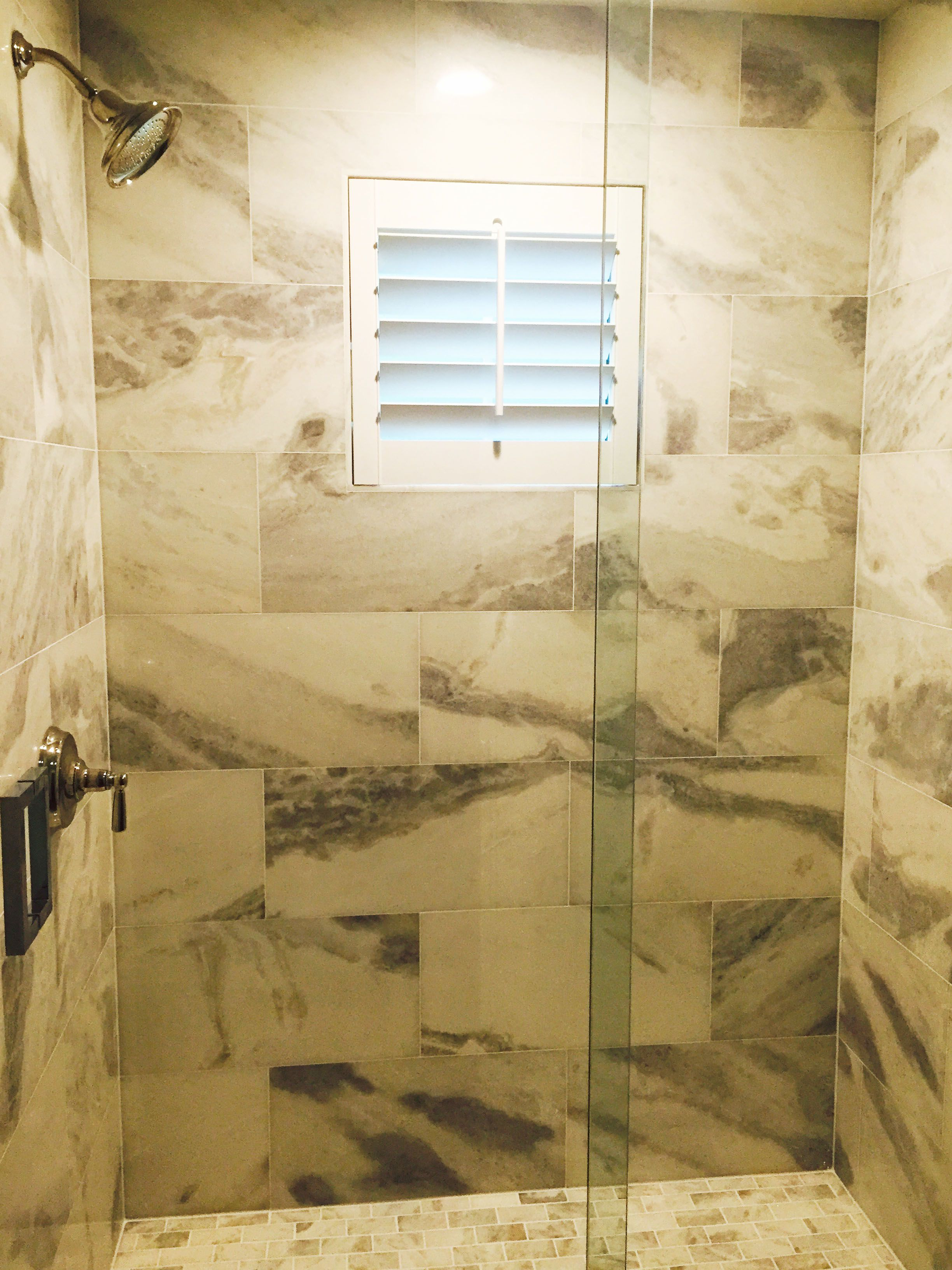 Beautiful marbled shower with our Louverwood shutters on the small ...
