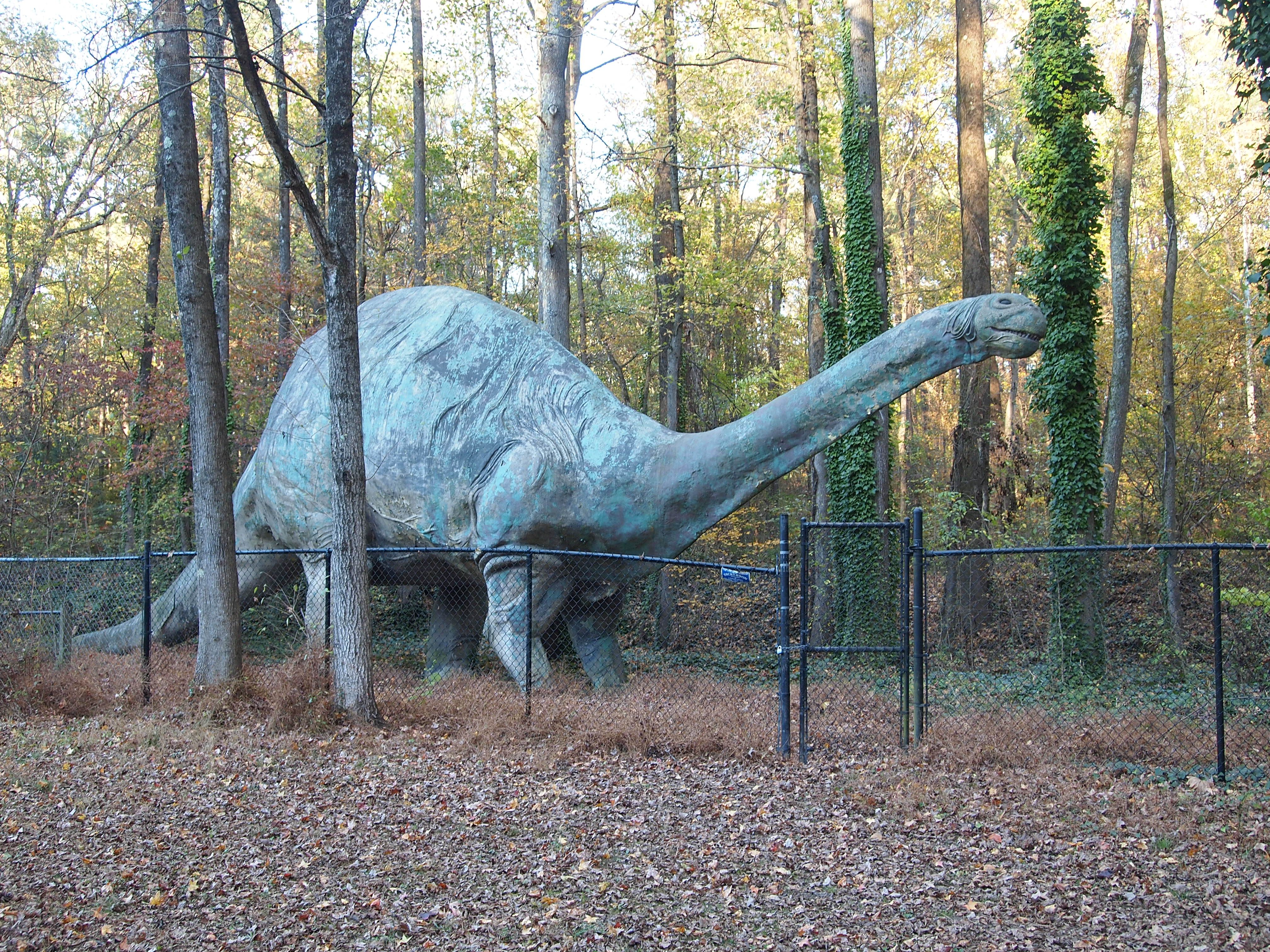 The Brontosaurus statue from the old Museum of Life & Science dinosaur trail. Visible from a greenway. It's out of date, and ugly (in my opinion), but iconic.  Photo by Naomi Parkhurst.