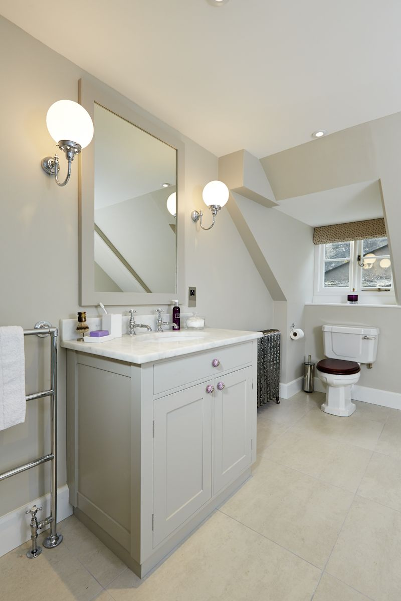 Shaker style vanity unit with marble top and heated mirror above ...