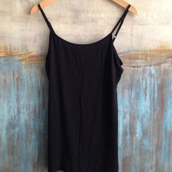 Anthropologie Hinge Layering Tank Size Small Anthropologie Hinge layering tank with adjustable straps and scoop neck line. Size Small. Color Black. Material 92/8 modal/spandex. Measurements : shoulders: 9, pits: 13, top to bottom: 34 Anthropologie Tops Tank Tops