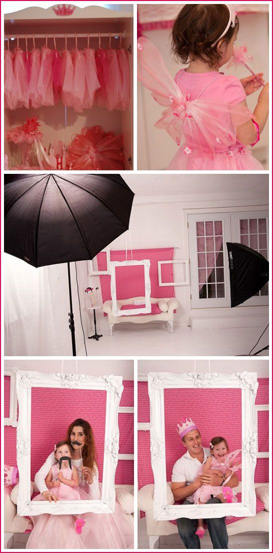 Photo shoots behind free hanging frames for party guests.