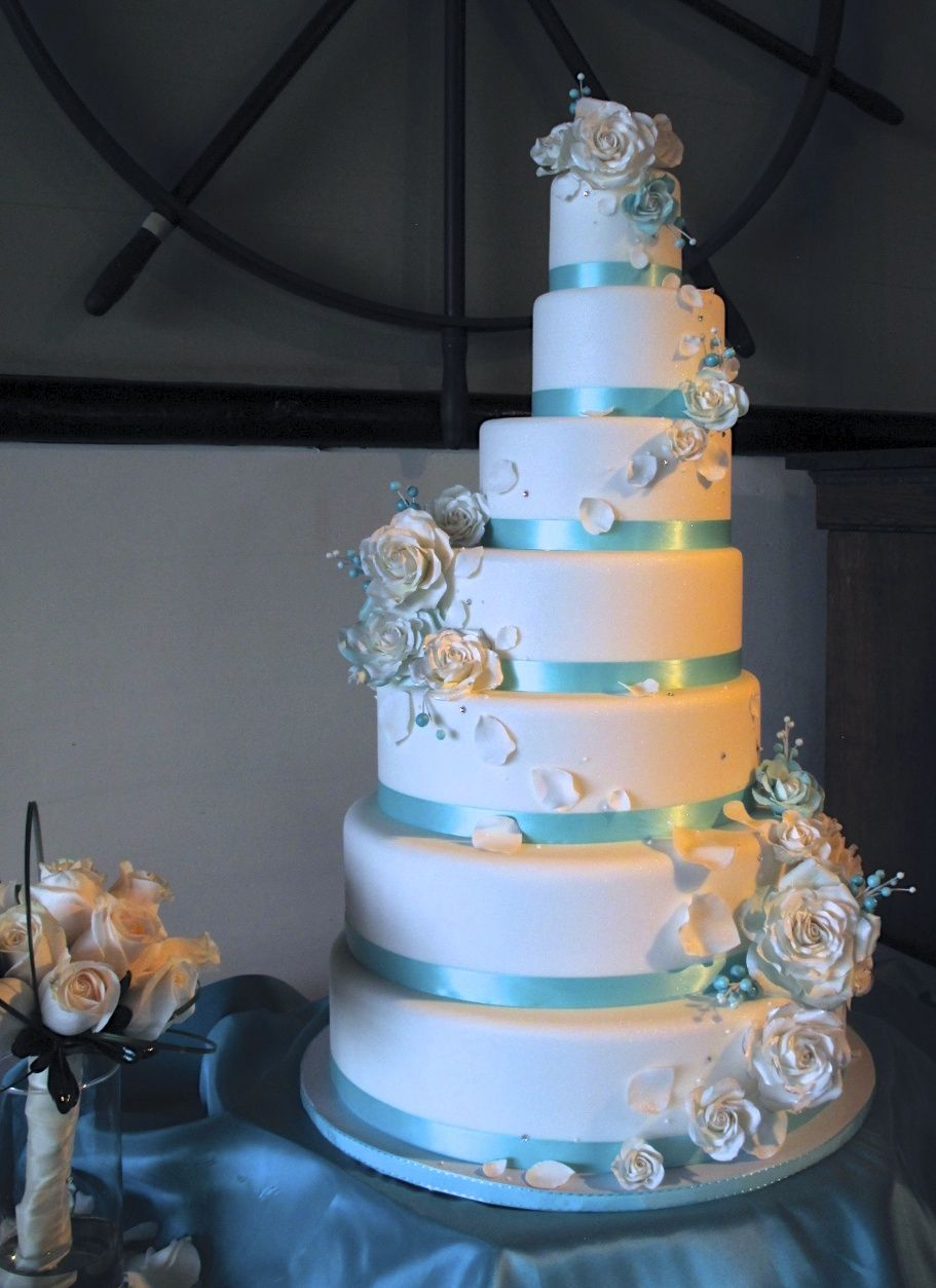Seven tier tiffany blue and white wedding cake with sugar roses from seven tier tiffany blue and white wedding cake with sugar roses from midori bakery izmirmasajfo