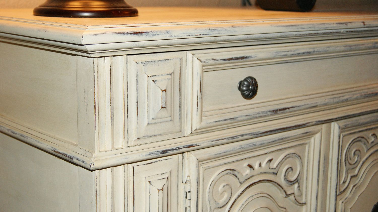 White distressed furniture with antique white distressed finish and functional cabinet space