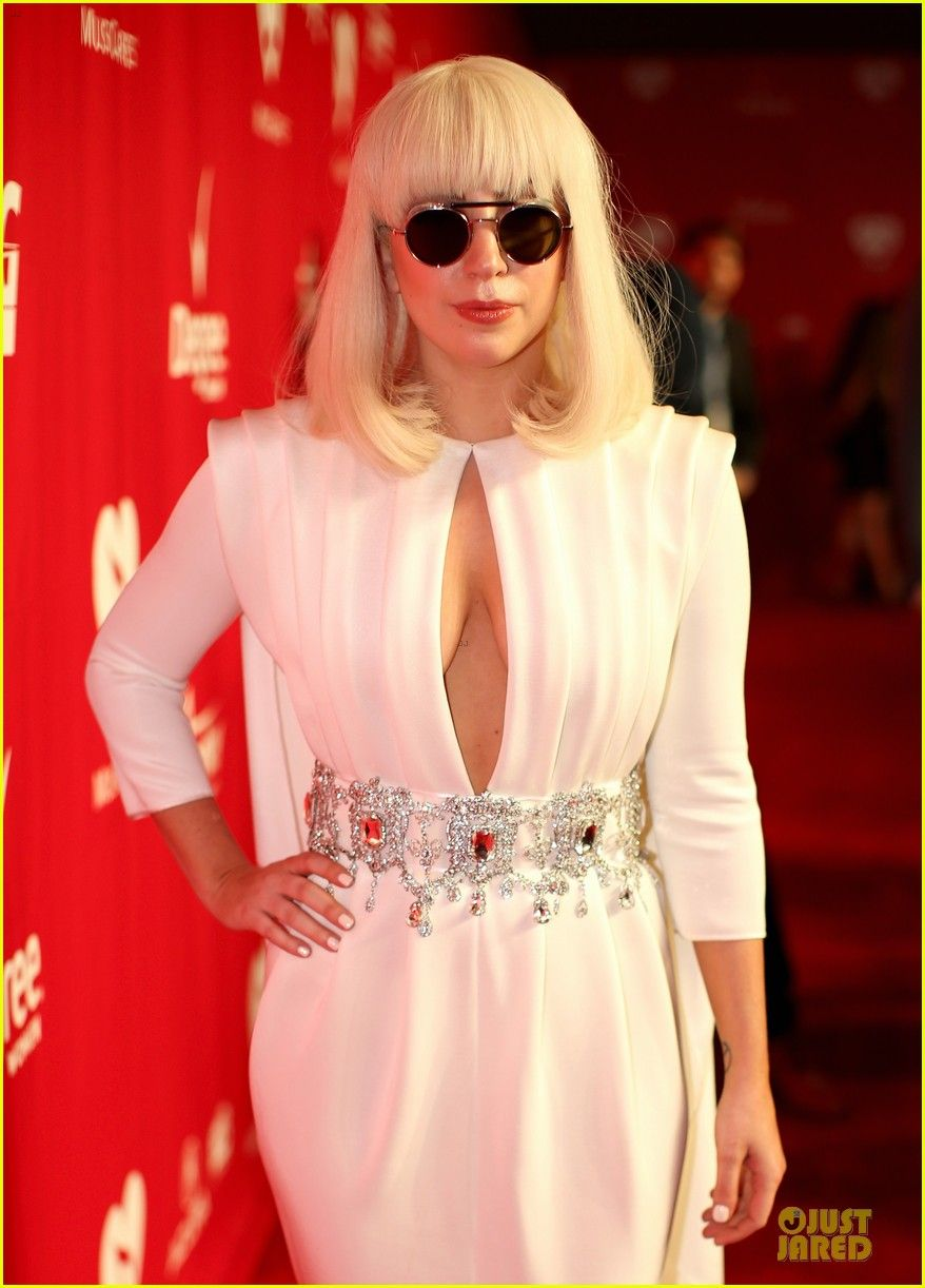 Lady gaga keeps it hot in a white cutoutdress while attending the