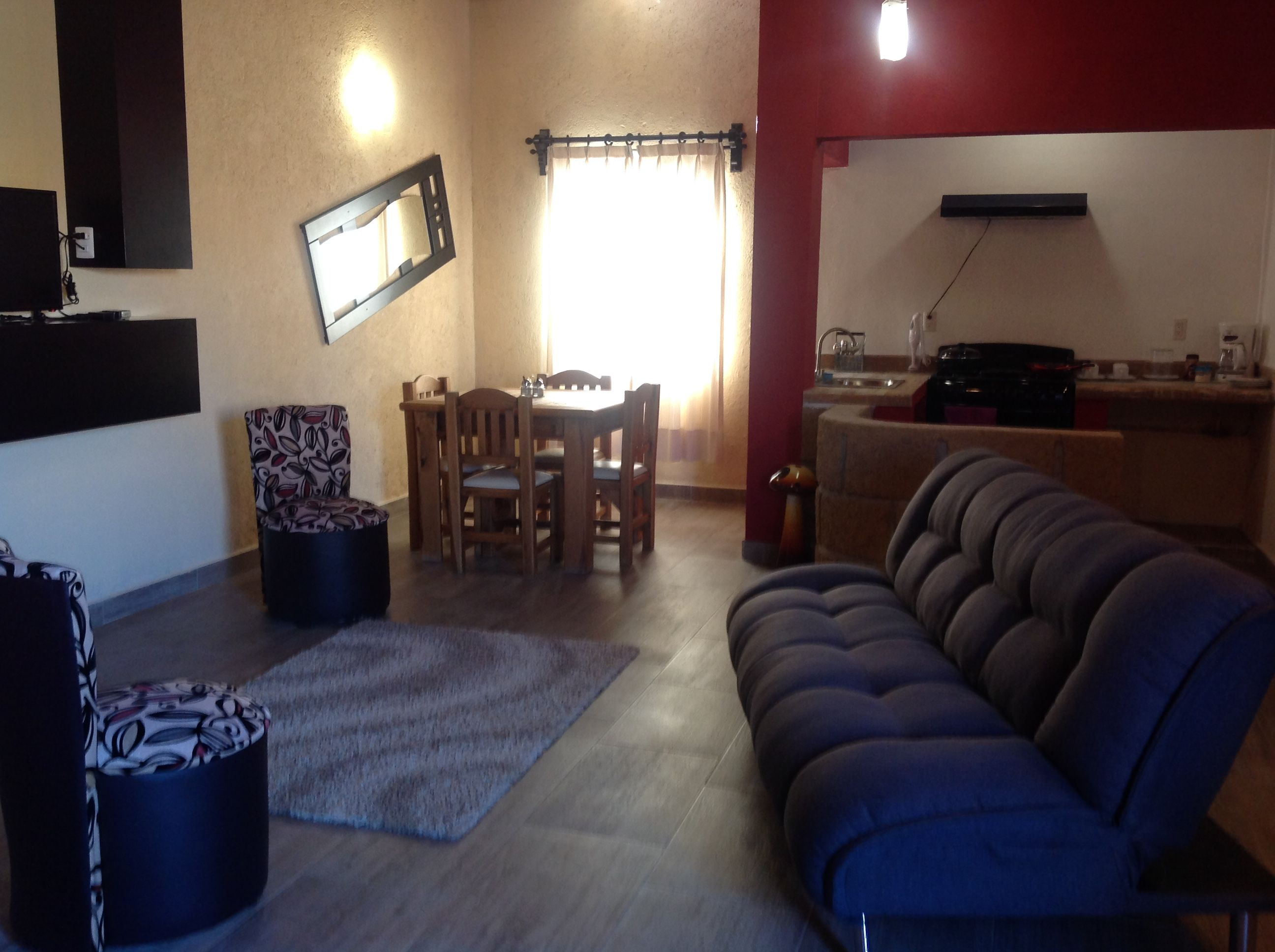 Estancia de la Suite de Lujo con sala comedor y cocina