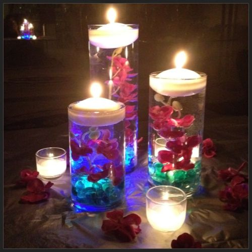 Floating candle centerpieces with flowers diy submerged
