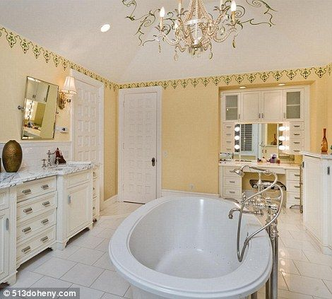 She doesn't do things by halves: Even the bathrooms are ornately decorated with chandeliers and lots of gold