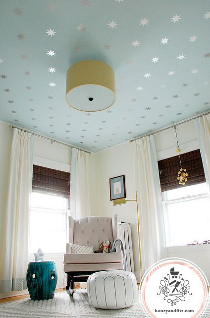 Take a different approach with your nursery walls by adding decals to the ceiling for a sparkling addition. via Honey and Fitz