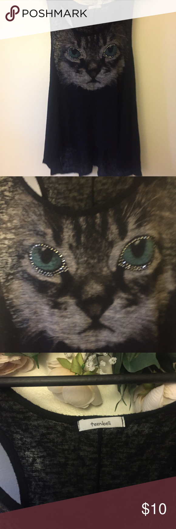 Teen Bell Cat shirt black This is a black tank with a image of a cat with rinestones! Very pretty there is no size tag but it fits like a 1x. There is a slight high in black and low in front. teenbell Tops Tank Tops