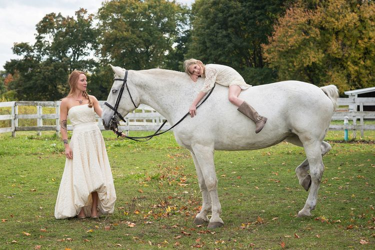 Sweet flower girl relaxing on her horse.  Love this image of a #country #bride.  #Berkshires #wedding
