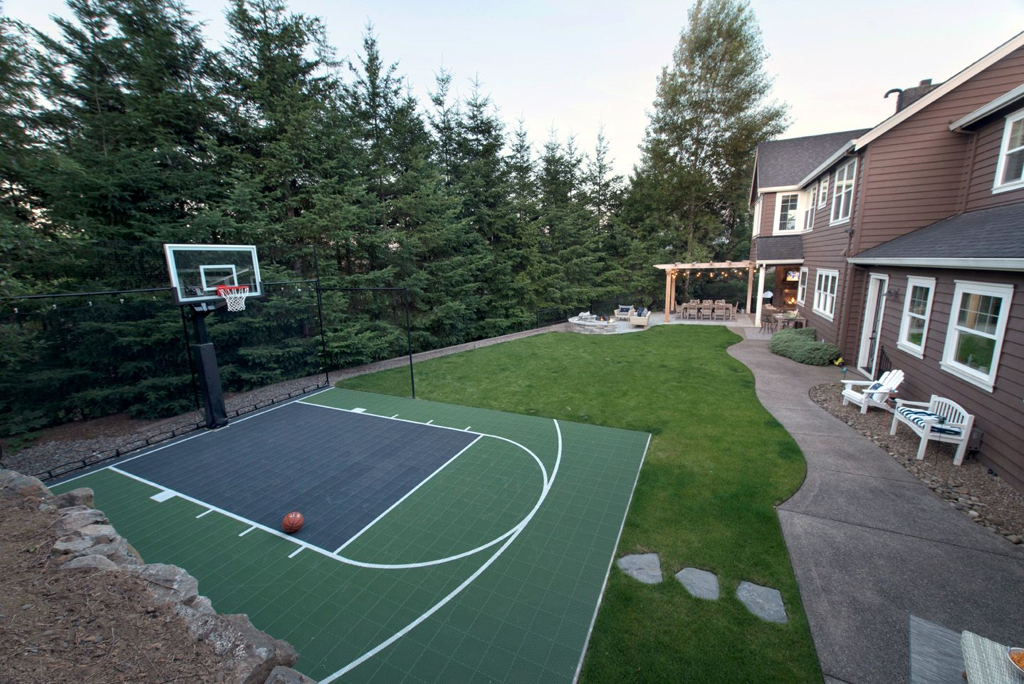Backyard Basketball Court Paradise Restored Landscaping Basketball Court Backyard Backyard Basketball Backyard Court Backyard landscaping ideas with basketball court