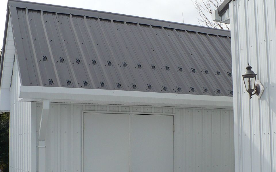 Pd30 Pad Style Snow Guard For Metal Roofing Shown Here In Charcoal To Match The Roofing Material Image From Wj Kelley Ll Metal Roof Living Roofs Roof Sealant