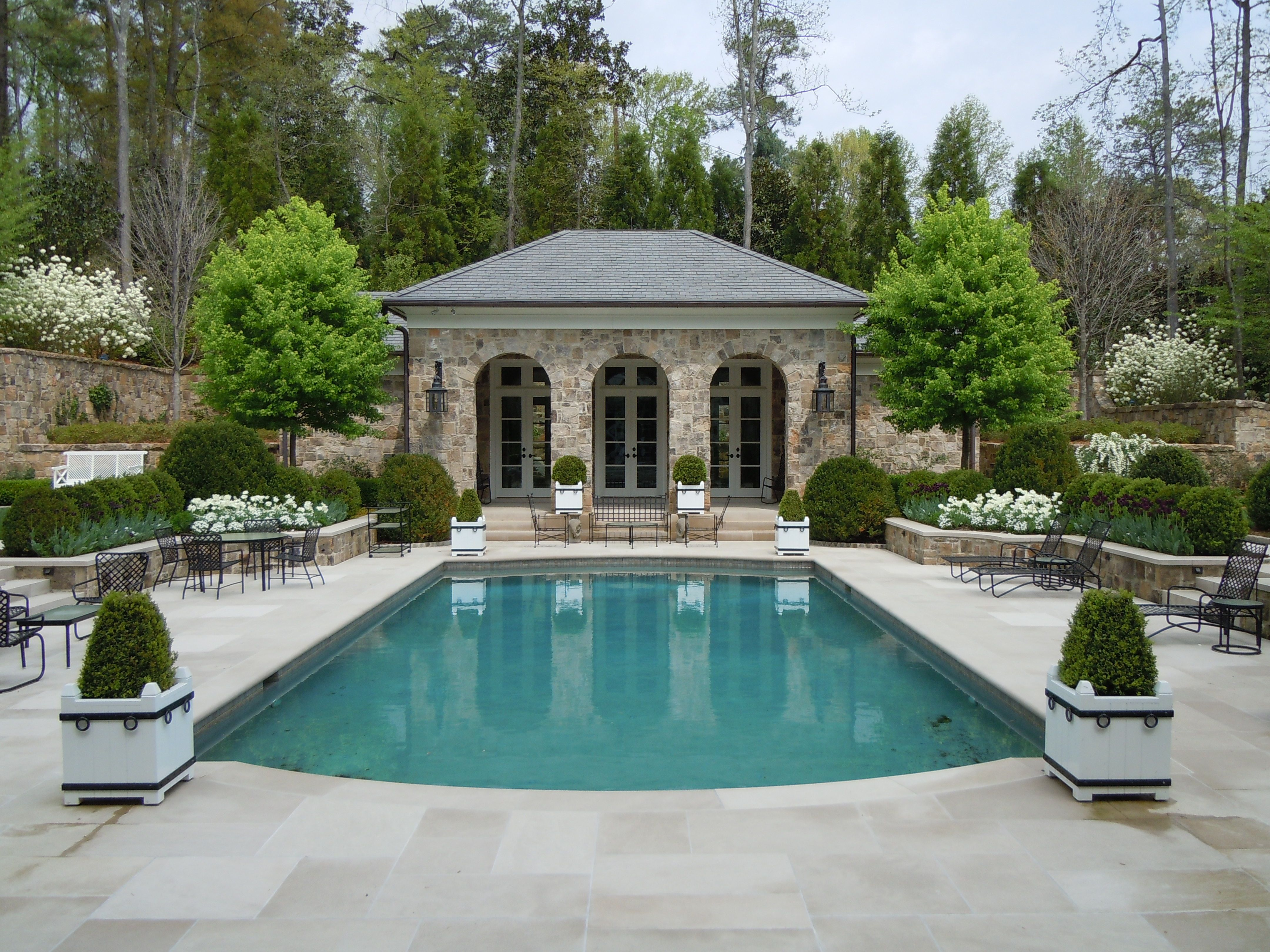 a pool and garden design by howard design studio white blooms in early spring - Pool Design Ideen Landschaft
