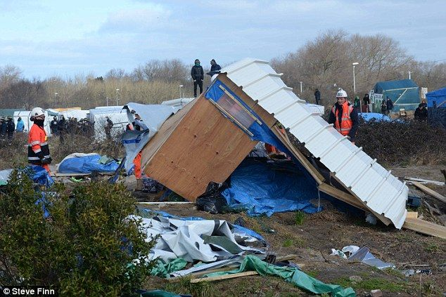 Collapsed: Now the debris of families' homes litter the site, which had grown into a small makeshift town