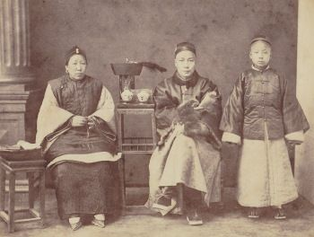 Studio portrait of a Chinese family (1860's)  William Saunders