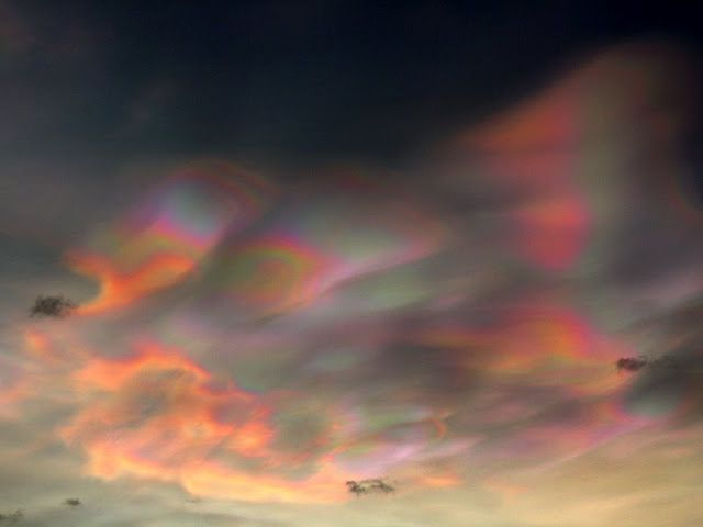 """Nacreous clouds are located in the stratosphere between 9 and 16 miles high. Their """"mother of pearl"""" colors come from sunlight striking tiny ice crystals inside the clouds. Very low temperatures near -85 degrees C are required to form the crystals, which is why nacreous clouds are seen mainly during winter over places like Alaska, Iceland and Scandinavia."""