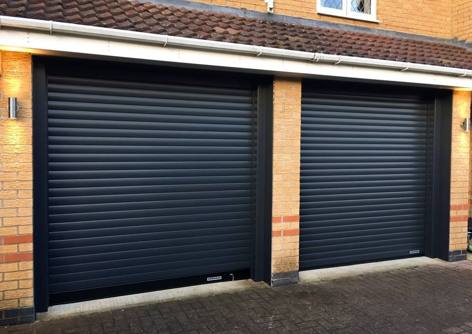 An Installation Of A Sleek Pair Of Hormann Rollmatic Garage Doors Facade House Garage Doors Garage Door Installation