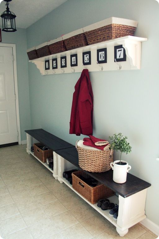 I adore her idea of cutting an old coffee table in half and painting it to use for two end-to end benches in the entry way. I also LOVE her DIY framed numbers for the coat hooks. Initials would also be fun.