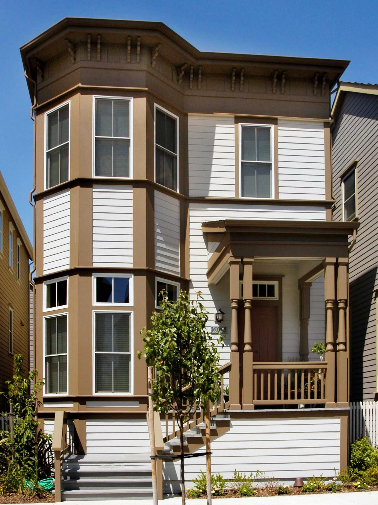 Front Design Of Row House Part - 40: ... Was So Common In Century-built Row Houses, Remains A Popular Style In  Home Design. Itu0027s Evident Here In The Two-level Bay Windows And Front-porch  Design