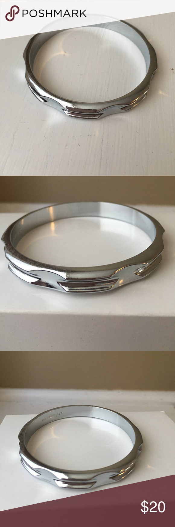 HairBanglez Wrist-Saver Hair tie Bracelet Bought on GROMMET, when the concept was Brand-New! Never Worn. Does feel nice and sturdy on wrist. Saves your wrist from restricting Hair Ties! Stainless Steel- meant for sensitive skin friendly! Jewelry Bracelets