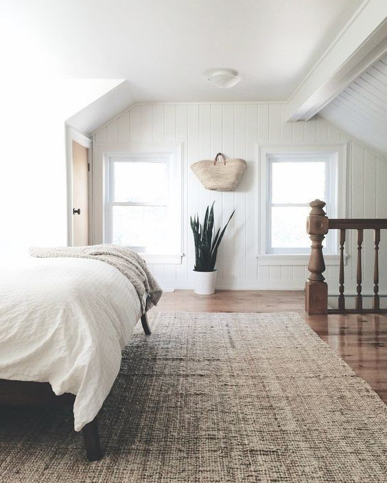 Simple Minimalist Bedroom With Snake Plant White Bedding