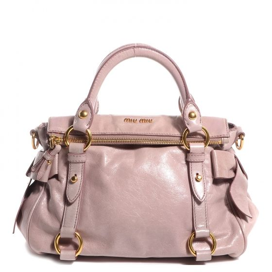f09b825b9b38 This is an authentic MIU MIU Vitello Lux Mini Bow Bag in Mughetto. This  stylish tote is crafted of shiny calfskin leather in pale pink.