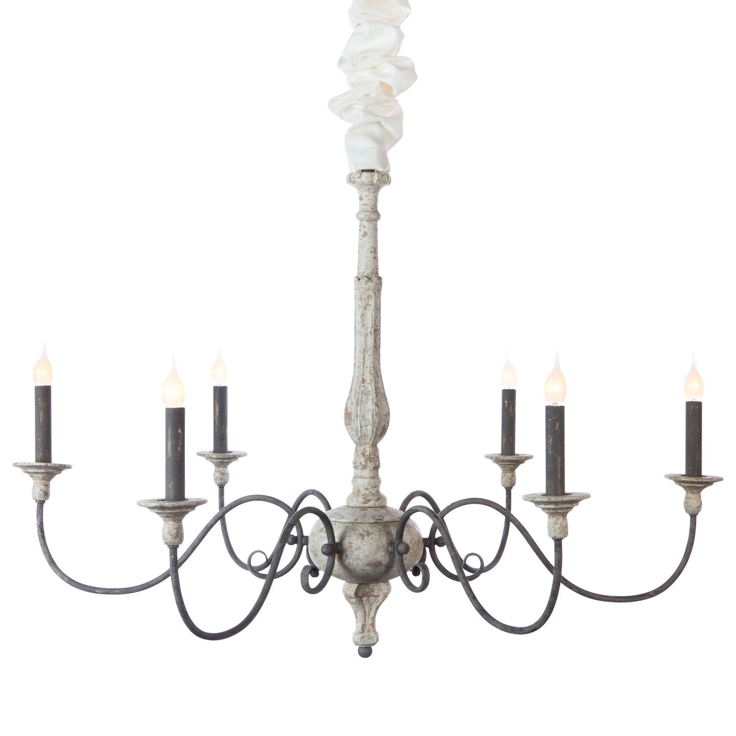 """The perfect addition to a French country-style foyer or living space, the Aiden Gray Rosemary chandelier presents a grand silhouette and distressed white finish for a touch of rustic elegance. Six scrolling metal arms support classic candelabra lights and simple turned bobeches for a timeless look, while the carved center column maintains a sophisticated air with a thoroughly traditional design. 36""""W x 36""""D x 26.5""""H. Zinc in Rustic White finish. Accepts six 60W candelabra bulb..."""