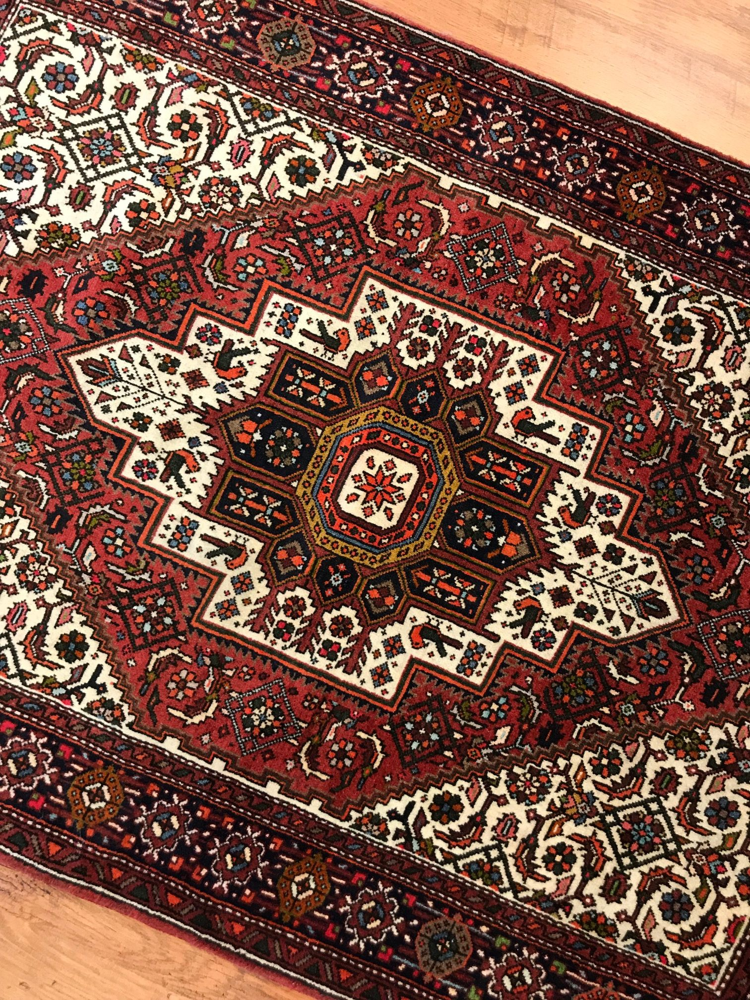 A handmade gholtogh persian rug from iran made of wool and cotton