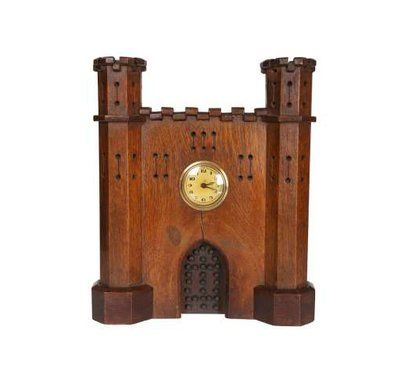 A Victorian oak mantel clock in the form of a castle, carved with turrets and recessed door, the small dial with Arabic numerals. 33.5cm. Lot number 485, Thomas Watson Fine Sale, 24.02.2015. Estimate: £50-£70. Bid online at http://www.the-saleroom.com/en-gb/auction-catalogues/thomas-watson.