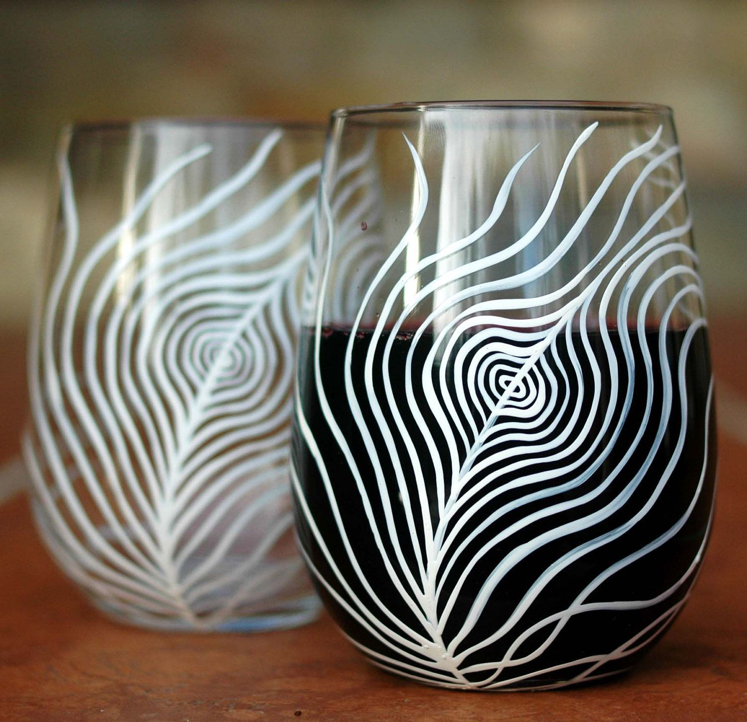 White Peacock Feather Stemless Wine Glasses. Hand-painted by Mary Elizabeth Arts