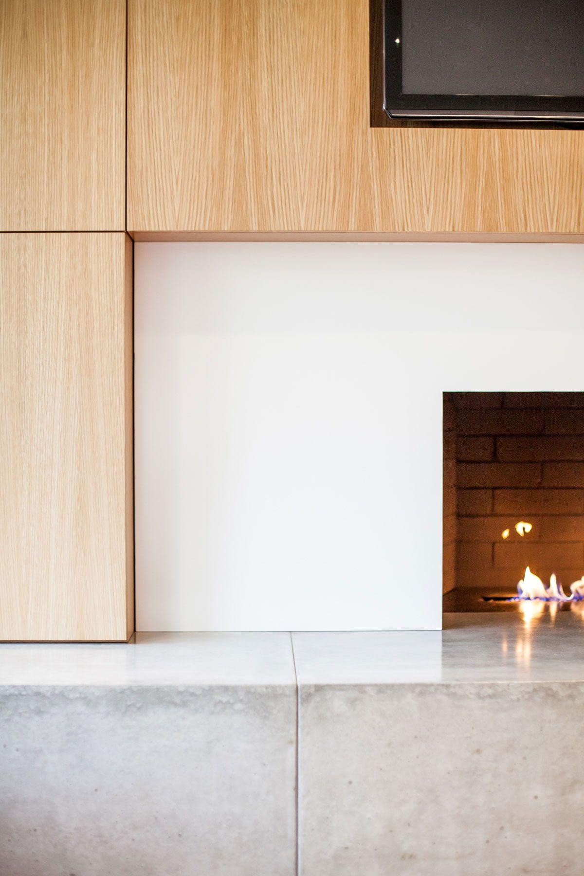 Detail of modern fireplace surround concrete hearth powder
