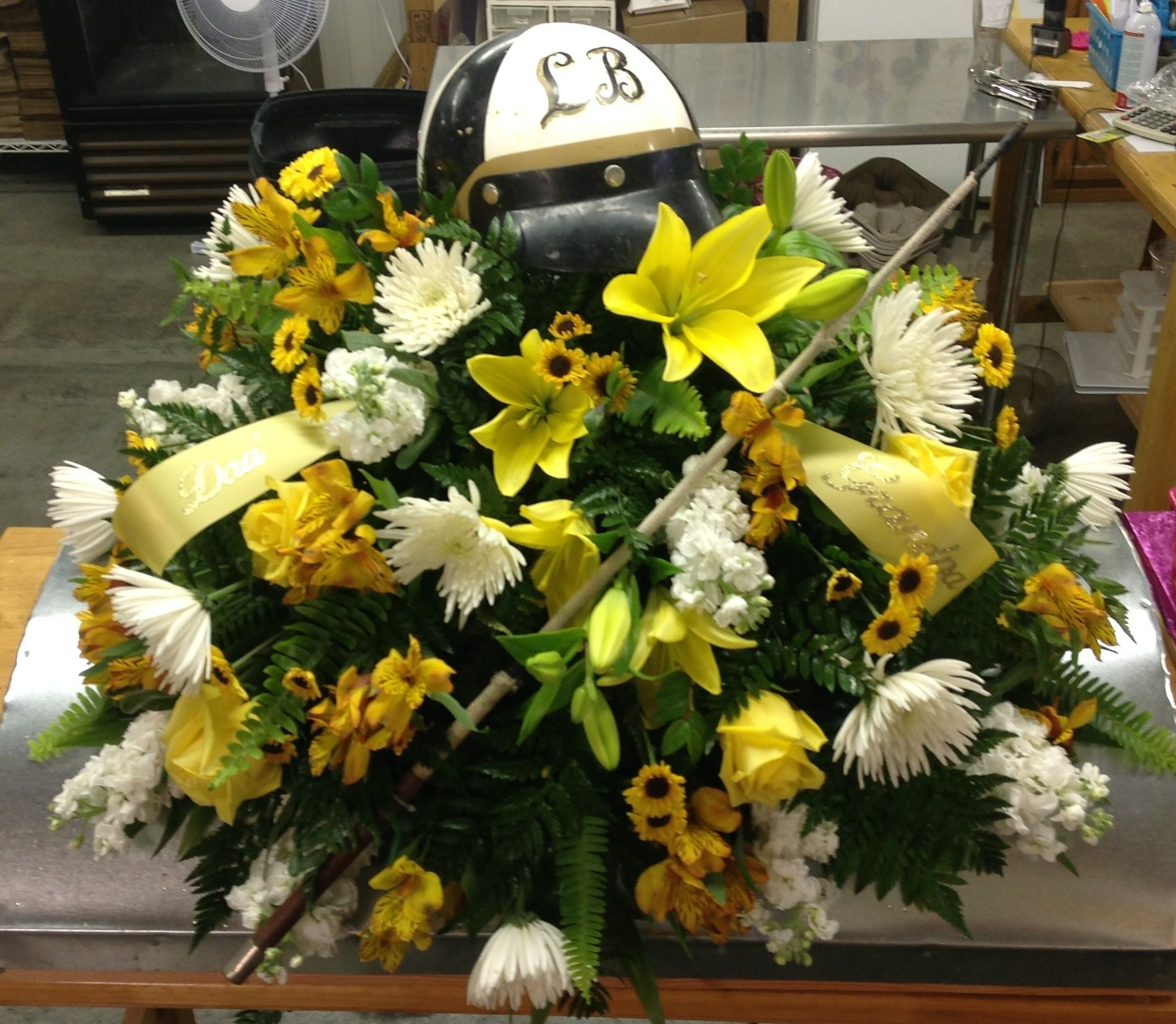 Yellow & White Casket Spray for a local Hero