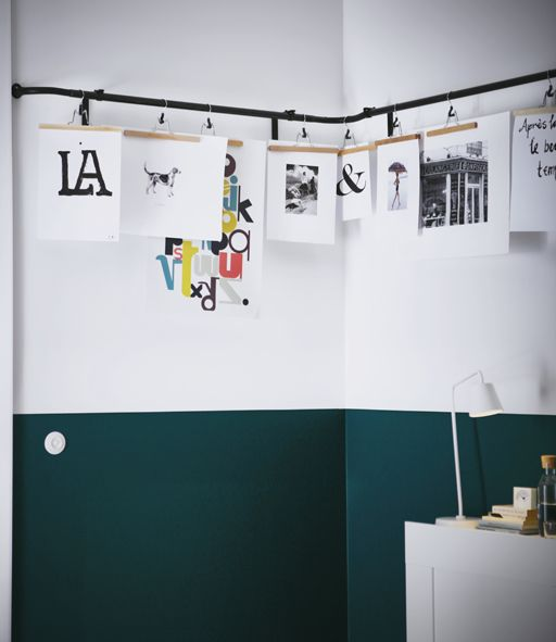 Different Pieces Of Artwork Are Hung From An Ikea Hugad Curtain