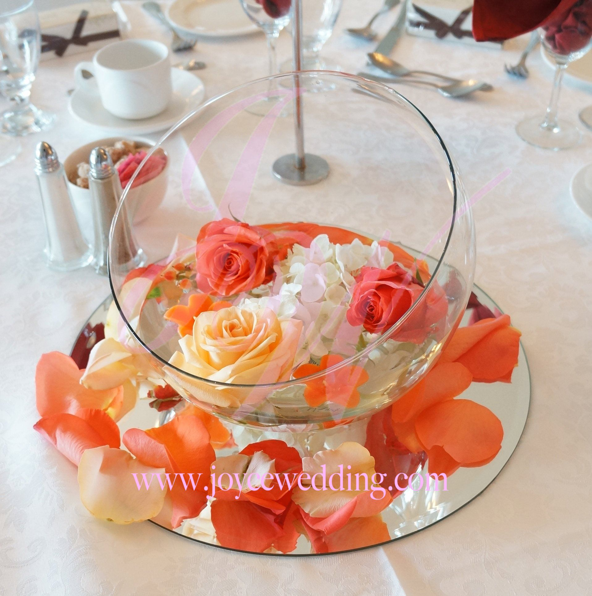 Coral And Peach Centerpiece With Floating Hydrangea And Rose On A Round Mirror With Petals Peach Candle Coral Flowers Centerpieces Mirror Centerpiece