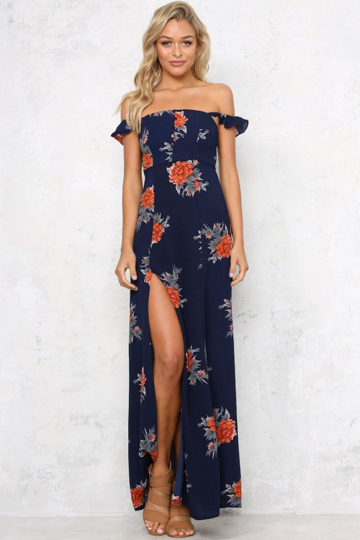 1e8f70125634 The Tell Me More Maxi Dress is a loose fitting, floral print maxi dress  with mini, off-the-shoulder sleeves. It features button details down the  front of ...