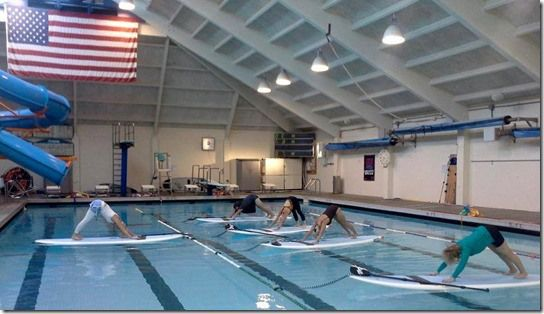 SUP Yoga, Stand UP Paddle in the pool with a Yoga Class
