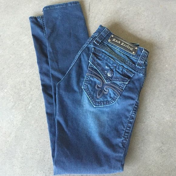 Rock Revival 'Jen' Skinny Jeans Rock Revival Skinny Jeans with a medium/dark wash. Jen Skinny, size 28, inseam 31 inches measures 14 inches across the waist laying flat. Gently used only a couple of times and in excellent condition . On the right back pocket is a slight color irregularity, it's not a stain! Rock Revival Jeans Skinny