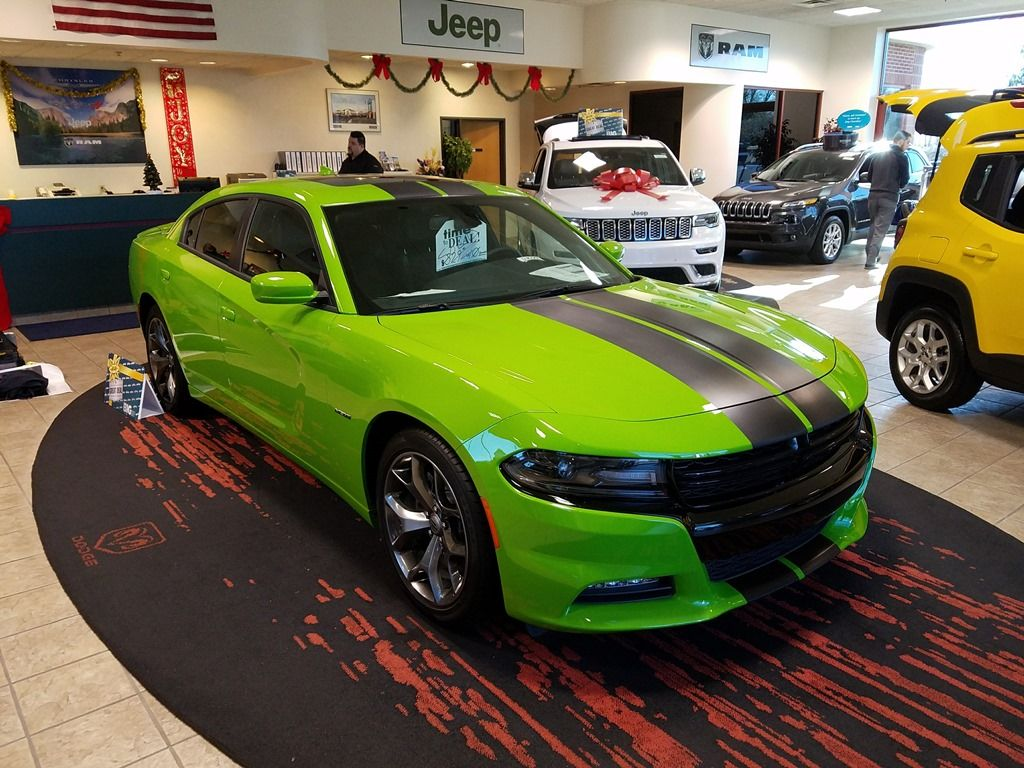 Carbon fiber racing stripes installed on a lime green charger for orchard chrysler racingstripes