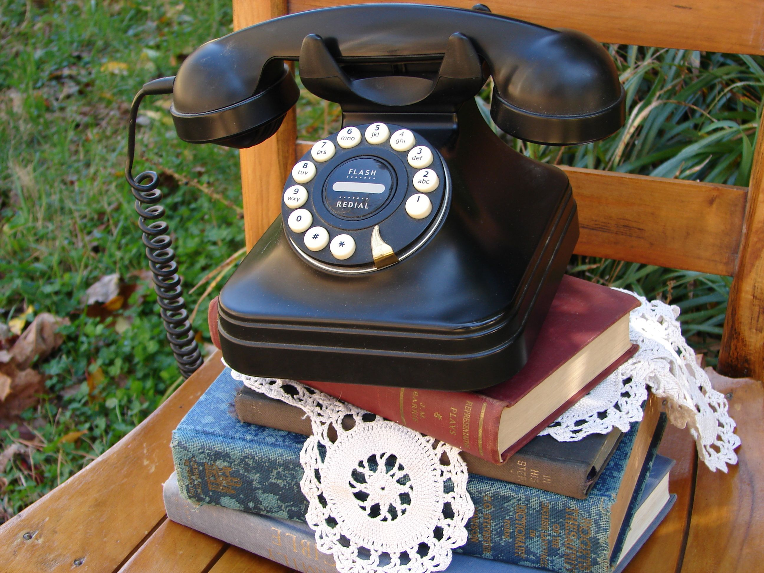 Vintage books and vintage-inspired phone from The Vintage Chicks Rentals