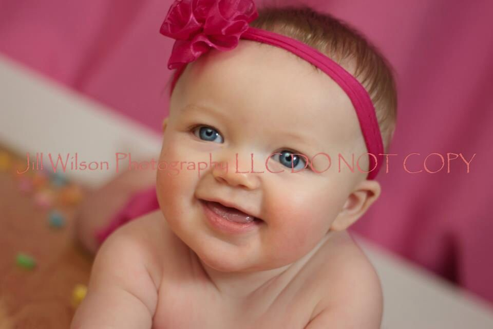 Valentines day baby photo with heart candy and pink back drop www.jillwilsonphotographyllc.com  chagrin Falls Ohio newborn photographer