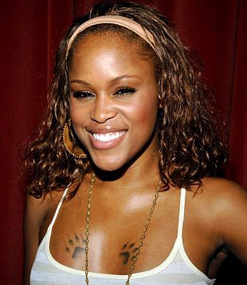 Eve The Rap Artist Rapper Eve S Chest Paw Tattoo Photo Celebrity Tattoos Celebrity Tattoos Chest Tattoo Small Girl Tattoos