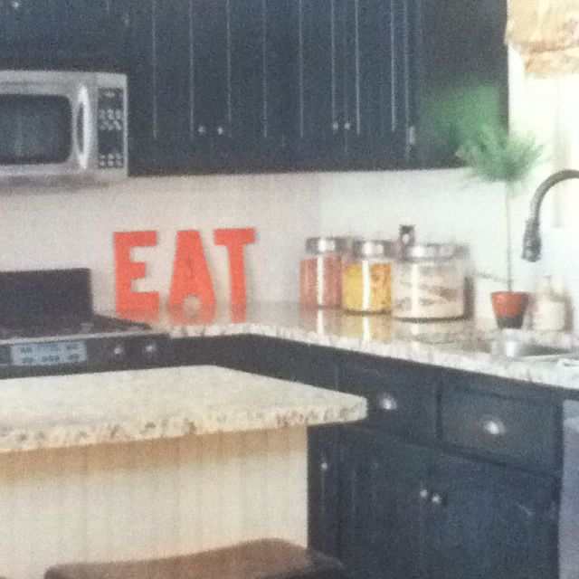 Black Kitchen Cabinets And Bold Colored Letters Spelling Eat Black Kitchen Cabinets Kitchen Inspirations Kitchen