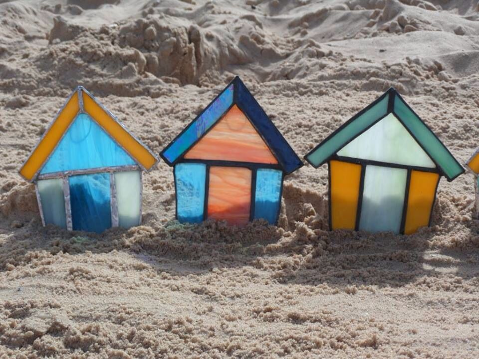 Stained glass beach huts in oak block