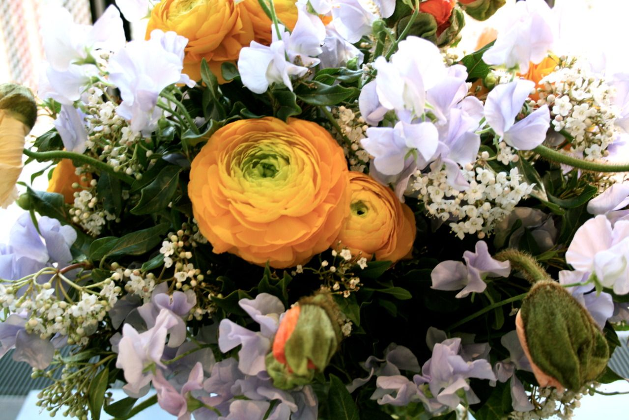 Easter wedding bouquets  I love this combination of flowersorange ranunculus lavender