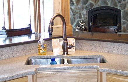 An Undermount Double Bowl Stainless Steel Corner Kitchen Sink In Combination With Quartz Counters Bronze