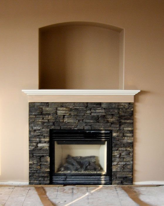 Ledgestone fireplace that stops at a mantel one idea for for Faux marble fireplace mantels