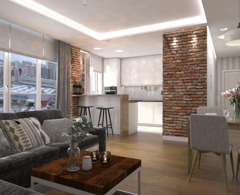 Salon z aneksem kuchennym. połączenie cegły z ciepłym drewnem i