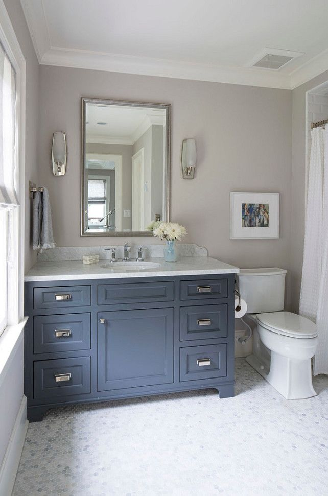I like this color scheme for the guest bathroom Navy cabinet paint color is  Benjamin Moore French Beret Wall paint color is Farrow and Ball Cornforth  White. Small grey   white bathroom   Awesome  Grey and Tile