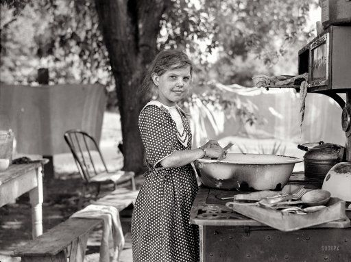 """July 1936. """"Child of migratory fruit worker in tent camp at Yakima, Washington."""""""